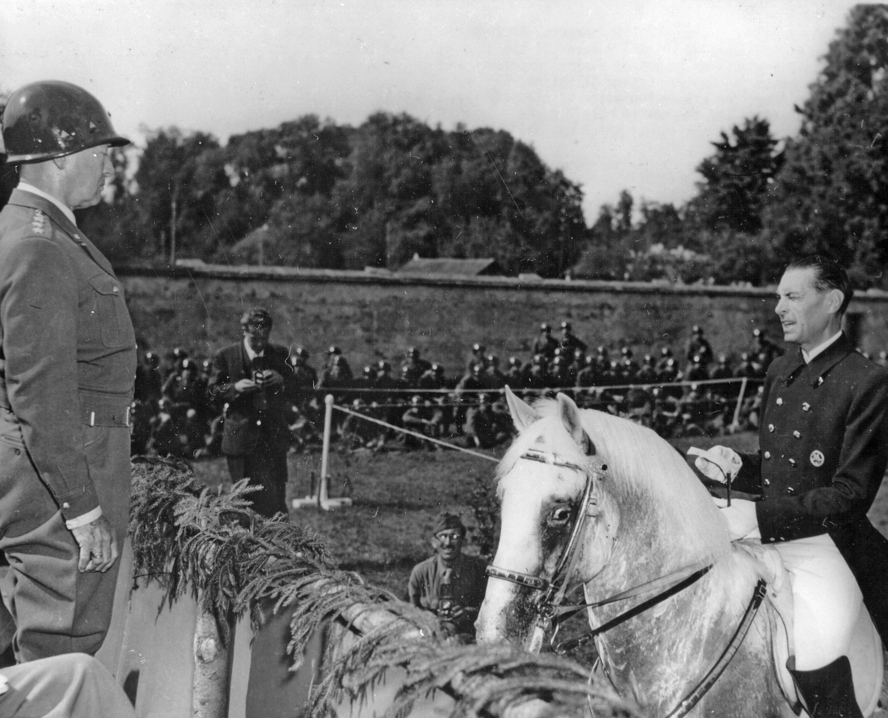 General George Patton and Colonel Alois Podhajsky discuss the future of the Lipizzaner.